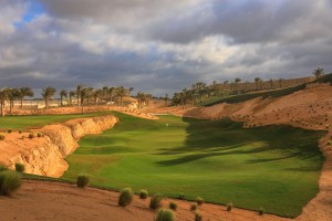 The design incorporates the natural quarry features. This is the split level par 3, 6th hole.