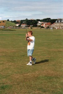Young Alex Hay learning golf in Scotland.